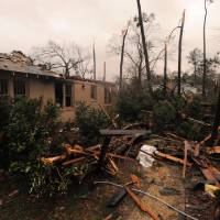 Photo - A house was damaged in Hattiesburg Miss., after a tornado passed through the city Sunday, Feb. 10, 2013. AP photo  Ryan Moore