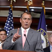 Photo -   FILE - In this June 28, 2012 file photo, House Speaker John Boehner of Ohio, flanked by House Majority Leader Eric Cantor of Va., left, and Rep. Tom Price, R-Ga., speaks during a news conference on Capitol Hill in Washington. It looks like a tax, smells like a tax, and the Supreme Court says it must be a tax. But politicians in both parties are squirming over how to define the Thing in President Barack Obama's health care law that requires people to pay up if they don't get health insurance. The problem for Obama is that, if the Thing is indeed a tax, he is by definition a raiser of taxes on the middle class, which he promised not to be. If that sounds like an opportunity for Republican presidential rival Mitt Romney, well, it's not that simple. (AP Photo/J. Scott Applewhite, File)