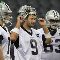 Photo -   Dallas Cowboys quarterback Tony Romo (9) watches during NFL football practice at Cowboys Stadium, Wednesday, May 30, 2012 in Arlington, Texas. Also shown are tight end George Bryan (49), quarterback Stephen McGee (7) and guard Harland Gunn (63). (AP Photo/LM Otero)