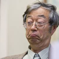 Photo - Dorian S. Nakamoto listens during an interview with the Associated Press, Thursday, March 6, 2014 in Los Angeles. Nakamoto, the man that Newsweek claims is the founder of Bitcoin, denies he had anything to do with it and says he had never even heard of the digital currency until his son told him he had been contacted by a reporter three weeks ago. (AP Photo/Damian Dovarganes)