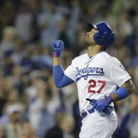 Photo - Los Angeles Dodgers' Matt Kemp pumps his fist after scoring on a single hit by Adrian Gonzalez during the sixth inning of a baseball game against the Chicago White Sox on Monday, June 2, 2014, in Los Angeles. (AP Photo/Jae C. Hong)