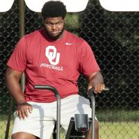 Photo -                    Defensive tackle Jordan Phillips played well Saturday despite limited snaps.                     Photo by Steve Sisney, The Oklahoman