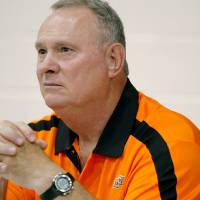 Photo - COLLEGE FOOTBALL: OSU defensive coordinator Bill Young  listens to questions from the media during Media Day at Gallagher-Iba Arena on the Oklahoma State University campus in Stillwater on Saturday, Aug. 6, 2011. Photo by John Clanton, The Oklahoman ORG XMIT: KOD