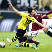 Photo - Dortmund's Henrikh Mkhitaryan of Armenia, center, scores during the German first division Bundesliga soccer match between BvB Borussia Dortmund and 1.FC Nuremberg in Dortmund, Germany, Saturday, March 1, 2014. (AP Photo/Frank Augstein)