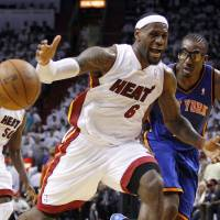Photo -   Miami Heat's LeBron James (6) loses control of the ball as New York Knicks' Amare Stoudemire, right, looks on in the first half of an NBA basketball game in the first round of the Eastern Conference playoffs in Miami, Monday, April 30, 2012. (AP Photo/Lynne Sladky)
