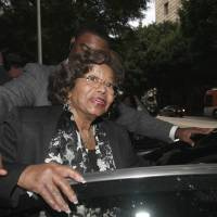 Photo -   FILE - In this Jan. 6, 2011 file photo, Katherine Jackson, Michael Jackson's mother, leaves court after a hearing for Jackson's doctor, Conrad Murray, in Los Angeles. Jackson on Tuesday, July 31, 2012 announced she will spend what would have been her son Michael's 54th birthday in the family's hometown of Gary, Ind., which is planning a candlelight vigil, concert and other events to honor the pop superstar and his mother. (AP Photo/Nick Ut, File)
