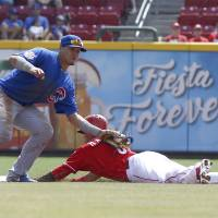Photo - Cincinnati Reds' Billy Hamilton, right, steals second base under Chicago Cubs second baseman Javier Baez, left, in the first inning of a baseball game, Thursday, Aug. 28, 2014, in Cincinnati. (AP Photo/David Kohl)