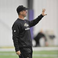 Photo - Baltimore Ravens coach John Harbaugh calls to his team during football practice Saturday, Jan. 26, 2013 in Owings Mills, Md. (AP Photo/Gail Burton).