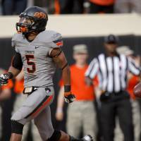 Photo - Oklahoma State's Josh Stewart (5) scores a touchdown during a college football game between Oklahoma State University (OSU) and the University of West Virginia at Boone Pickens Stadium in Stillwater, Okla., Saturday, Nov. 10, 2012. Photo by Bryan Terry, The Oklahoman