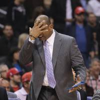 Photo - Los Angeles Clippers' Doc Rivers reacts while directing his team during the first half of an NBA basketball game against the Brooklyn Nets on Saturday, Nov. 16, 2013, in Los Angeles. (AP Photo/Jae C. Hong)