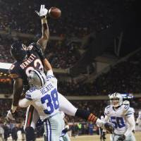 Photo - Dallas Cowboys safety Jeff Heath (38) breaks up a pass intended for Chicago Bears tight end Martellus Bennett (83) during the first half of an NFL football game, Monday, Dec. 9, 2013, in Chicago. (AP Photo/Charles Rex Arbogast)
