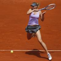 Photo - Maria Sharapova from Russia returns the ball during a Madrid Open tennis tournament match against Christina McHale from US, in Madrid, Spain, Tuesday, May 6, 2014. (AP Photo/Andres Kudacki)