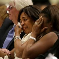 Photo - Donna Kelly Pratte, mother of Chris Kelly of the rap duo Kris Kross, wipes a tear during the funeral for her son, Thursday, May 9, 2013, in Atlanta. The 34-year-old Kelly was found dead May 1 of a suspected drug overdose. Kriss Kross was introduced to the music world in 1992 by music producer and rapper Jermaine Dupri after he discovered the pair at a mall in southwest Atlanta. Kelly performed alongside Chris Smith, who known as