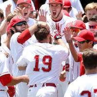 Photo - Louisiana-Lafayette's Jace Conrad (19) celebrates with his team after hitting a grand slam in the second inning during an NCAA college baseball tournament regional game against Jackson State, Sunday, June 1, 2014, in Lafayette, La. (AP Photo/Jonathan Bachman)
