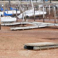 Photo - Boats at the Oklahoma City Yacht Club sit on dry land Tuesday at Lake Hefner in Oklahoma City. The lake has hit its lowest water level in its 66-year history. PHOTO BY PAUL HELLSTERN, THE OKLAHOMAN