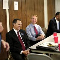 Photo - U.S. Senate candidates Brogdon, Lankford and Shannon laugh at one of the comments made by debate moderator before debate begins on Wednesday,  Monday, April 16, 2014. Photo by Jim Beckel, The Oklahoman