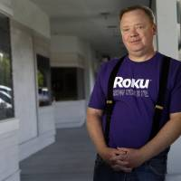 Photo - In this May 19, 2014 photo, Anthony Wood, CEO of Roku, poses for a portrait at the company's headquarters in Saratoga, Calif. While Netflix CEO Reed Hastings gets marquee billing for building an Internet video service with 48 million worldwide subscribers, Wood has quietly worked behind the scenes making Roku streaming devices that make it easier and more enjoyable to watch Netflix's vast library of movies and TV shows. (AP Photo/Marcio Jose Sanchez)