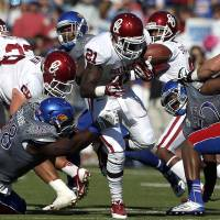Photo -  Freshman running back Keith Ford fumbled in the first half of Saturday's win over Kansas. PHOTO BY SARAH PHIPPS, THE OKLAHOMAN
