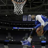 Photo - Memphis forward D.J. Stephens dunks during practice for a second-round game of the NCAA college basketball tournament at The Palace in Auburn Hills, Mich., Wednesday, March 20, 2013. Memphis plays Saint Mary's on Thursday. (AP Photo/Paul Sancya)