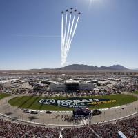 Photo - The United States Air Force Thunderbirds performs a fly-by during the national anthem before the NASCAR Sprint Cup Series auto race, Sunday, March 10, 2013 in Las Vegas. (AP Photo/Julie Jacobson)