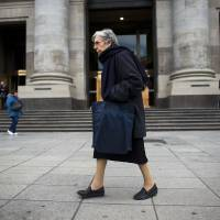 Photo - A woman walks in front of Argentina's Central Bank in Buenos Aires, Argentina, Friday, Aug. 23, 2013. A U.S. appeals court dealt Argentina a blow Friday in the lengthy legal battle over the country's massive 2001 default, upholding a ruling ordering it to pay $1.4 billion to bondholders. Argentine officials have warned the impact of a ruling against the country could be severe. The decision also could have major repercussions for other countries trying to decide whether to put lenders before their own citizens as they rebuild their economies. (AP Photo/Victor R. Caivano)