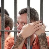 Photo - Inmate Matthew Benton stands in a cell at the Midwest City jail, the largest city jail in Oklahoma. Midwest City officials are working together with the state's mental health agency to start a new jail diversion program. It's similar to drug court or mental health court but on a city level.  David McDaniel - The Oklahoman