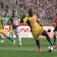 Photo - In this photo dated May 2, 2014, JS Kabylie striker Albert Ebosse of Cameroon controls the ball during the final of the Algerian soccer Cup in Blida near the Algerian capital, Algiers. Ebosse died after being hit in the head by an object thrown from the crowd at a top-flight league game in Algeria last August 23, 2014. Angry fans in Algeria pelted their own soccer team with rocks after they lost a game, killing the star player in the latest incident of fan violence in this North African country. Like much of the rest of the continent, Algeria's restless youth are passionate about soccer but with little other outlet for their daily frustration, violence haunts the games. (AP Photo)
