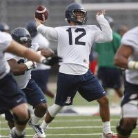 Photo - In this Aug. 2, 2014, photo, Arizona quarterback Anu Solomon throws a pass during NCAA college football practice in Tucson, Ariz. Redshirt freshman Anu Solomon emerged from a four-way race and will be Arizona's season-opening quarterback. Solomon will debut against his hometown team UNLV on Friday night, Aug. 29,  at Arizona Stadium, though coach Rich Rodriguez said the other quarterbacks may still see action. (AP Photo/Arizona Daily Star, Mike Christy)  ALL LOCAL TELEVISION OUT; PAC-12 OUT; MANDATORY CREDIT