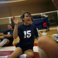 Photo -  Kendra Lancaster celebrates with teammates during practice for the US Paralympic Volleyball team  at the University of Central Oklahoma in Edmond, on Tuesday, July 29, 2008.