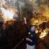 Photo - Sparky Spaulding gives a tour at Howe Caverns on Thursday, May 1, 2014, in Howes Cave, N.Y. A handful of local business owners are vying to build casinos in upstate New York, joining a bidding competition that includes gambling giants like Caesars and Genting. (AP Photo/Mike Groll)