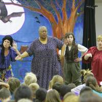 Photo - From left, Amy Nevius, Trena Brown, MacKenzie Mallen and Sandy Oliver with the Ryhthmically Speaking acting troupe perform Monday at the Norman Public Library. PHOTO bY DAVID MCDANIEL, THE OKLAHOMAN