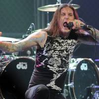 Photo - FILE - In this file photo taken Thursday, April 8, 2010, Tim Lambesis of As I Lay Dying performs at the second annual Revolver Golden Gods Awards in Los Angeles. Authorities say the singer of Grammy-nominated heavy metal band As I Lay Dying has been arrested Tuesday May 7, 2013 in Southern California after trying to hire an undercover detective to kill his estranged wife. The San Diego County Sheriff's Department says in a statement that 32-year-old Tim Lambesis was arrested Tuesday in Oceanside. (AP Photo/Chris Pizzello, File)