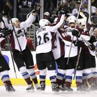 Photo - Members of the Colorado Avalanche celebrate a game-winning goal by Jamie McGinn in overtime of an NHL hockey game against the Los Angeles Kings on Saturday, Nov. 23, 2013, in Los Angeles. The Avalanche won 1-0 in overtime. (AP Photo/Jae C. Hong)