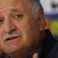 Photo - Brazil's coach Luiz Felipe Scolari answers questions during a press conference at the Granja Comary training center in Teresopolis, Brazil, Wednesday, July 9, 2014. Brazilians woke up this morning to dreadful headlines describing their soccer team's historic defeat of 7-1 to Germany in the World Cup's semifinal. (AP Photo/Leo Correa)