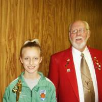 Photo - Cheyenne King, of Midwest City holds her trophy while standing next to Hoop Shoot Chairman Pete Clements.  PHOTO PROVIDED BY  MIDWEST CITY ELKS LODGE    ORG XMIT: 0903021551208206