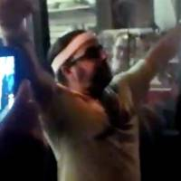 Photo -   CORRECTS SOURCE TO SARAH BERNARD - In this frame grab made from video on Friday, Oct. 5, 2012, and provided by Sarah Bernard, Edward Archbold celebrates winning a roach-eating contest at Ben Siegel Reptile Store in Deerfield Beach, Fla. Archbold, 32, died shortly after downing dozens of the live bugs as well as worms, authorities said Monday, Oct. 8. Authorities were waiting for results of an autopsy to determine a cause of death. (AP Photo/Courtesy Sarah Bernard)