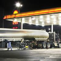 Photo - In this photo taken Nov. 20, 2009, a tanker truck makes a fuel delivery at a Little Rock, Ark., gas station. Retail gasoline prices headed downward to begin one of the country's busiest travel weeks, with more than 33 million people expected to hit the road for the Thanksgiving holiday. AP Photo  Danny Johnston - AP
