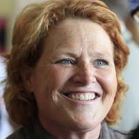 Photo -   Democratic U.S. Senate candidate Heidi Heitkamp smiles as she speaks to supporters during a campaign stop at the Coordinated Campaign HQ in Grand Forks, N.D, Monday, Nov. 5, 2012. Heitkamp is running against Republican Rick Berg for the North Dakota's U.S Senate seat. (AP Photo/LM Otero)