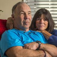Photo - In this Jan. 23, 2014 photo, Pro Football Hall of Famer Joe DeLamielleure poses with his wife Gerri in their home in Charlotte, N.C. DeLamielleure is convinced that he, like many former professional football players, suffers from a concussion-related brain disease CTE brought on by the many head blows and concussions experienced during his 13 year NFL career. (AP Photo/Bob Leverone)