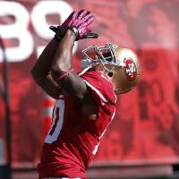 Photo -   San Francisco 49ers wide receiver Kyle Williams (10) celebrates after scoring on a touchdown pass from quarterback Alex Smith during the second quarter of an NFL football game against the Buffalo Bills, Sunday, Oct. 7, 2012, in San Francisco. (AP Photo/Tony Avelar)