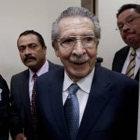 Photo - Guatemala's former dictator Efrain Rios Montt (1982-1983) leaves the courtroom after his pre-trial hearing in Guatemala City, Thursday, Jan. 24, 2013. A judge in Guatemala has begun pre-trial hearings in a genocide case against former dictator Efrain Rios Montt, who is accused of overseeing hundreds of killings when he ruled Guatemala from 1982 to 1983, at the height of the country's 36-year civil war. The war ended in peace accords in 1996, after 200,000 deaths. (AP Photo/Moises Castillo)