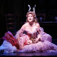 Photo - This theater image released by Sam Rudy Media Relations shows Laura Osnes as Cinderella, left, and  Victoria Clark, as her Fairy Godmother, during a performance of