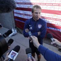 Photo - U.S. men's soccer coach Jurgen Klinsmann fields questions during the team's training camp in preparation for the World Cup, Wednesday, May 21, 2014, in Stanford, Calif. (AP Photo/Marcio Jose Sanchez)