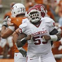 Photo - REACTION: Oklahoma's Casey Walker (53) reacts after a defensive stop during the Red River Rivalry college football game between the University of Oklahoma Sooners (OU) and the University of Texas Longhorns (UT) at the Cotton Bowl in Dallas, Saturday, Oct. 8, 2011. Photo by Chris Landsberger, The Oklahoman  ORG XMIT: KOD