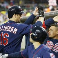 Photo - Minnesota Twins' Josh Willingham (16) is congratulated in the dugout after his three-run home run off Detroit Tigers starting pitcher Rick Porcello during the third inning of a baseball game in Detroit, Thursday, May 23, 2013. (AP Photo/Carlos Osorio)
