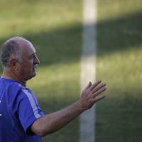 Photo - Brazil's coach Luiz Felipe Scolari gestures as he arrives for a training session in Fortaleza, Brazil, Thursday, July 3, 2014. Brazil will face Colombia on Friday in a quarterfinal soccer match at the World Cup. (AP Photo/Felipe Dana)