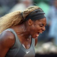 Photo - Serena Williams shouts after losing a point during her semifinal match against Ana Ivanovic at the Italian open tennis tournament in Rome, Saturday, May 17, 2014. Williams overcame a second-set lapse to beat 11th-seeded Ana Ivanovic 6-1, 3-6, 6-1 and gain a measure of revenge for a fourth-round loss to the Serb at this year's Australian Open. (AP Photo/Gregorio Borgia)