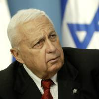 Photo - FILE - In this Sunday May 16, 2004 file photo, Israeli Prime Minister Ariel Sharon pauses during a news conference in his Jerusalem office regarding education reform. Israeli media outlets are reporting that Sharon has died Saturday, Jan. 11, 2014 at the age of 85. (AP Photo/Oded Balilty, File)