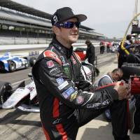 Photo - Kurt Busch stretches before the start of practice for the Indianapolis 500 IndyCar auto race at the Indianapolis Motor Speedway in Indianapolis, Monday, May 19, 2014. (AP Photo/Michael Conroy)