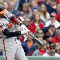Photo -   Baltimore Orioles' Adam Jones hits a two-run home run during the third inning of a baseball game against the Boston Red Sox in Boston, Saturday, May 5, 2012. (AP Photo/Michael Dwyer)